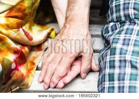 old couple over seventy years old Holding hands