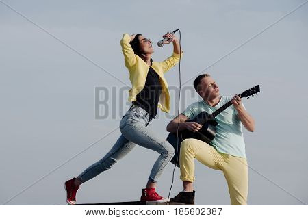 Music Band Of Man And Woman With Guitar And Microphone