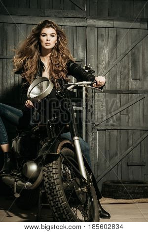 Biker In Leather Jacket Sitting On Vintage Motorcycle