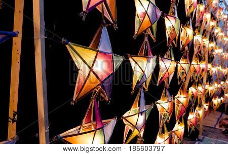 Multi colored star lamps and background .