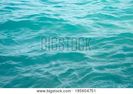 Turquote waters under sunlight create beautiful background and texture
