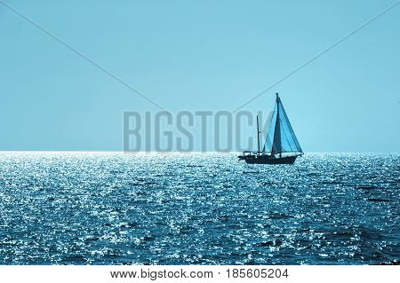 Sailboat on the horizon blue colored. Concept holidays sports traveling. Sailboat on the horizon blue colored. Concept holidays sports traveling. Small sailboats on the horizont on Croatia.