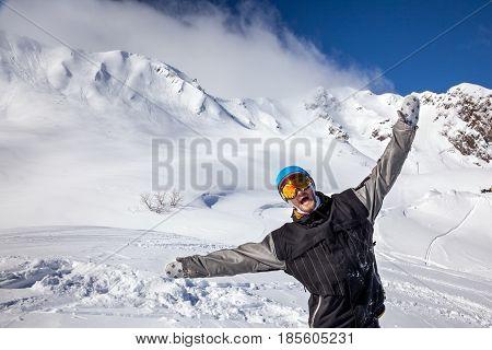 Joyful Snowboarder In The Mountains
