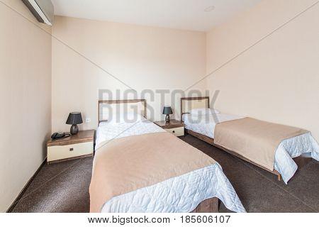 Twin room in modern hotel