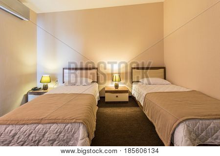 Twin room in modern hotel