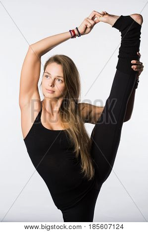sports exercise isolated on white background. Beautiful woman dressed in sportswear, doing stretching legs. view from the back. poster