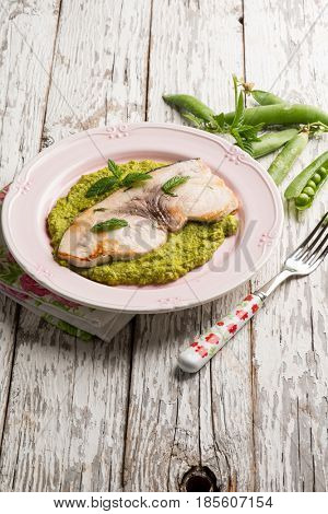 grilled swordfish over green peas cream