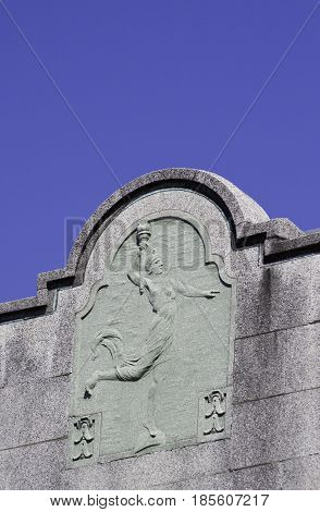 Burlington, Vermont - May 1, 2014 - Square view of the ornately carved top of a concrete block building at the Church Street Marketplace in Burlington, Vermont on a sunny day in early May.