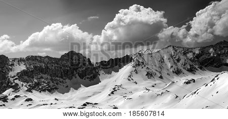 Black And White Panorama Of Snowy Mountains In Sun Day