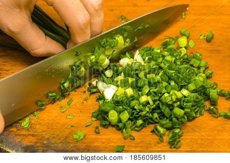 Chopped Green Onions On Wooden Cutting Board