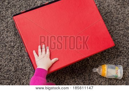 Baby Hand Opening A Gift Box