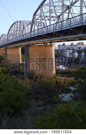 Steel and concrete highway bridge over the river in Llano, Texas