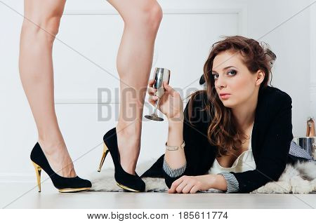 Beautiful Girl Is Drinking Wine On The Floor