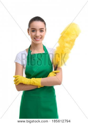 Cleaning concept. Young woman in green apron with duster on white background