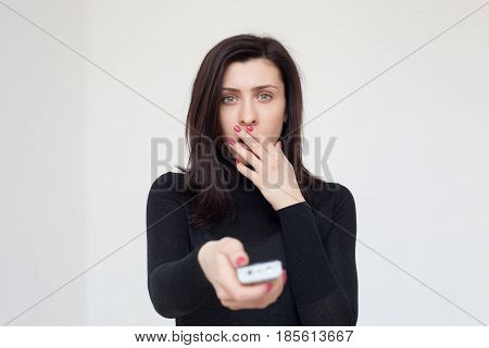 The Shocked Girl Switches The Program On Tv. She Is Frightened By The Information She Saw