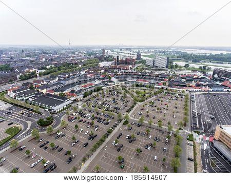 Roermond, Netherlands, 07.05.2017. Aerial shot sky view over horizon of the Mc Arthur Glen Designer Outlet shopping area