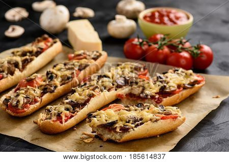 Homemade grilled baguettes with mushrooms, tomatoes and cheese.