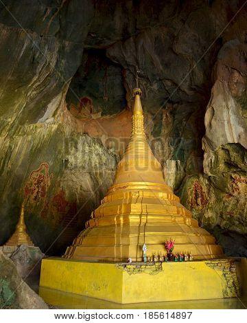 Majestic golden paya in sacred Yathaypyan Cave Hpa-An Myanmar.