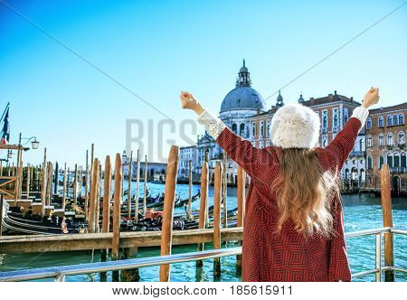 Trendy Tourist Woman In Venice, Italy In Winter Rejoicing