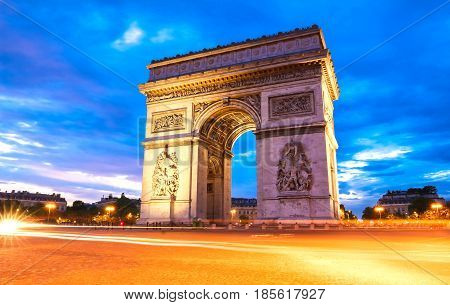 The famous Arch of Triumph at night, Paris, France