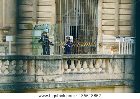 PARIS - MAY 7, 2017: A   policeman on the streets of  Paris on the day of the presidential election.