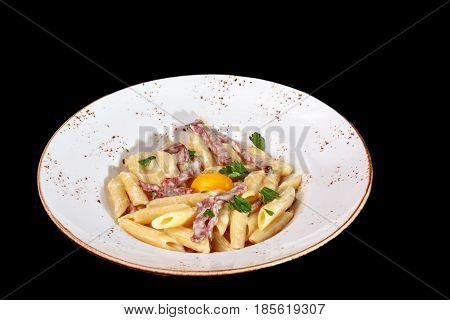Pasta Carbonara With Bacon And Raw Egg Yolk On The Plate.