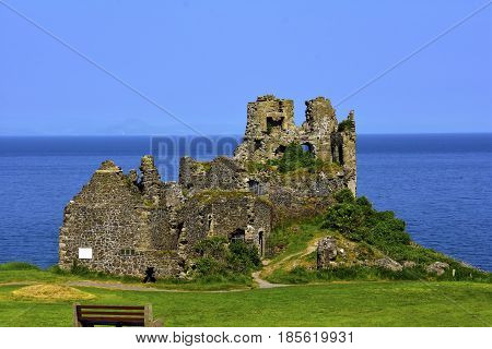 Ruins of Dunure Castle in Scotland with a blue sky