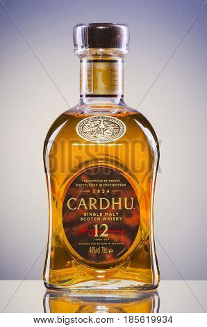Cardhu  whisky on gradient background. Cardhu is single malt scotch whisky produced in Speyside distillery near Archiestown, Moray, Scotland, founded in 1824.