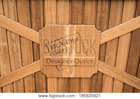 Roermond, Netherlands 07.05.2017 - Entrance sign logo on wood of the Mc Arthur Glen Designer Outlet shopping area