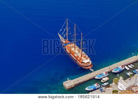 Passenger ship in the old port of Fira early sunny morning. Santorini. Greece.