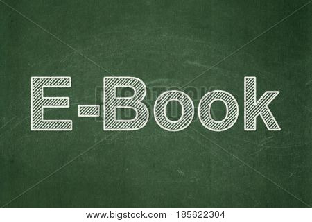 Learning concept: text E-Book on Green chalkboard background