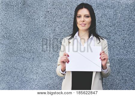 Successful Business Plan. Attractive Happy Business Woman In Formal Wear Holding Blank Flipchart In