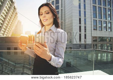 Successful Business Lady. Portrait Of Beautiful Confident Business Woman Using Her Phone While Drink