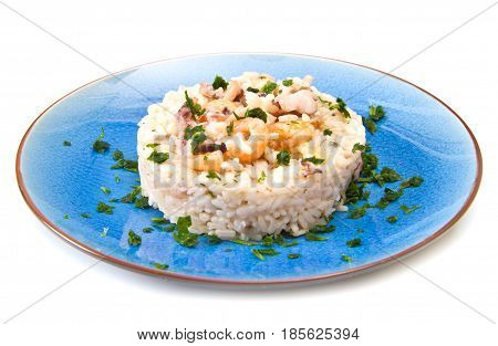 a delicious rice with seafood on blue dish