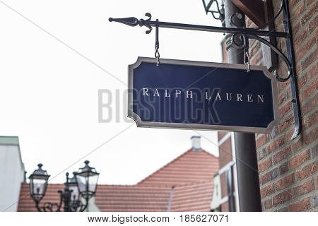 Roermond, Netherlands 07.05.2017 - Logo Sign of Polo Ralph Lauren Store in the Mc Arthur Glen Designer Outlet shopping area