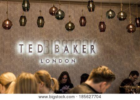 Roermond Netherlands 07.05.2017 - Logo people shopping Ted Baker London Store Mc Arthur Glen Designer Outlet shopping area