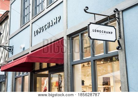 Roermond Netherlands 07.05.2017 - Logo of the Longchamp Store in the Mc Arthur Glen Designer Outlet shopping area