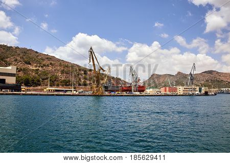 Seaport of Cartagena, Spain. Cartagena Shipyards, sea cranes, the Mediterranean Sea