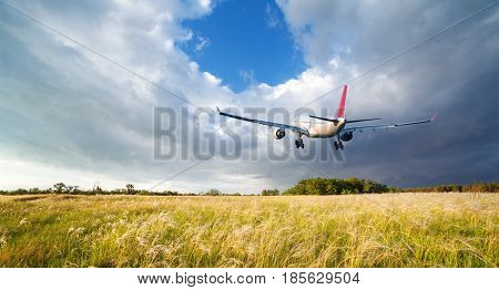 Landscape With Big White Passenger Airplane