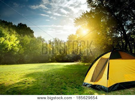 yellow tent in the mountain. tent in a camping site