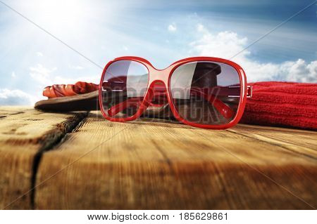 Summer Glasses on wood with towel adn slippers