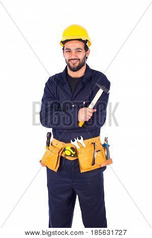 Handsome beard young worker smiling and holding a hammer guy wearing workwear and yellow helmet with belt equipment isolated on white background