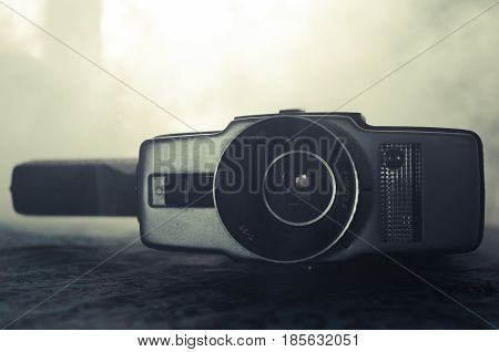 Classic Vintage Old 8Mm Movie Camera On Table With Fog Close Up. Selective Focus. Old Soviet Camera