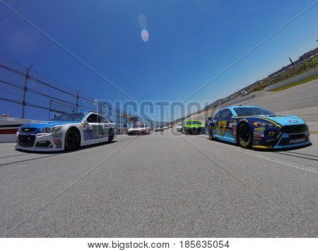 May 07, 2017 - Talladega, Alabama, USA: Ricky Stenhouse Jr. (17) and Dale Earnhardt Jr. (88) lead the pack to the green flag for the GEICO 500 at Talladega Superspeedway in Talladega, Alabama.