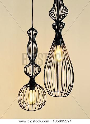 Pendant lamps made of black metal wire. Modern design.