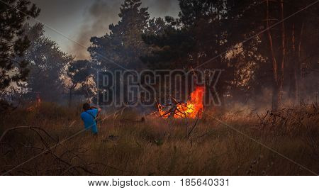 fire. forest fire is dangerous a person in the vicinity of a fire.