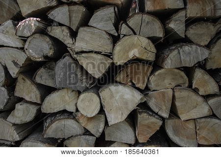 Pile Of Stacked Firewood In Rural Garden Ready For Winter. Preparation For The Winter. Wooden Log Ab