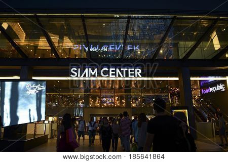 BANGKOK THAILAND- MAY 1 2017: People walking and shopping at shopping mall in twilight time.This is one of the biggest shopping center in Asia. It includes a wide range of specialty stores and restaurants.