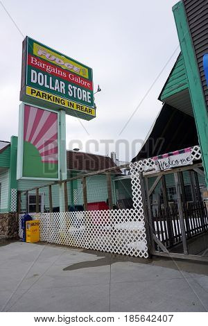 KALKASKA, MICHIGAN / UNITED STATES - NOVEMBER 27, 2016: The Dollar Store offers bargains galore on Cedar Street in downtown Kalkaska.