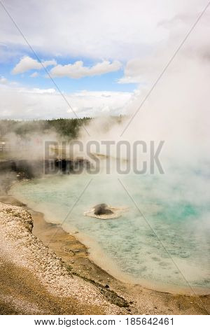 A vertical composition of gas rising from a thermal spring in the western USA